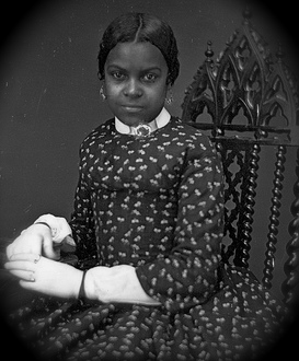 """Unidentified African American Woman Wearing White Gloves."" George Eastman House, http://www.flickr.com/photos/george_eastman_house/3334083572/"
