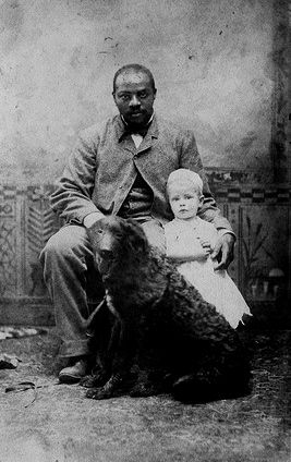 """Black man with white child and dog."" http://www.flickr.com/photos/george_eastman_house/2720789660/"