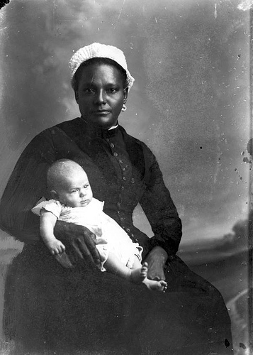"""White-capped nurse holding infant."" http://www.flickr.com/photos/floridamemory/3248110220/"