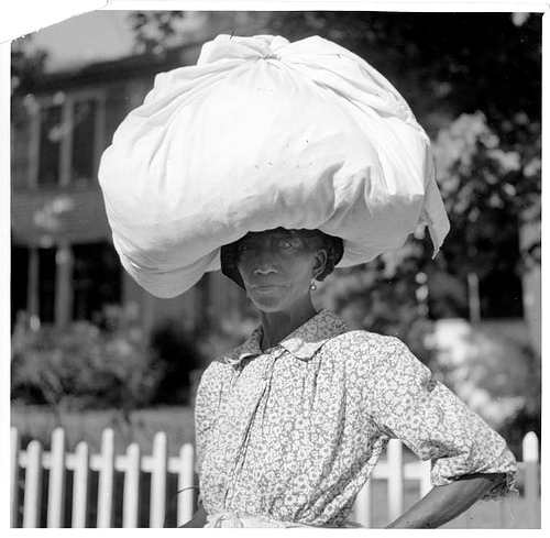 """Woman carrying bundle on head..."" New York Public Library http://www.flickr.com/photos/nypl/3109740199/"